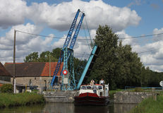 Bridge and canal boat on the canal du nivernais Stock Image
