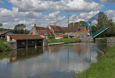 Bridge on the canal du nivernais. Landscape with drawbridge  on the canal du nivernais cycling track or velo burgundy in france Royalty Free Stock Image