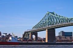 Bridge and cargo ship Royalty Free Stock Photo
