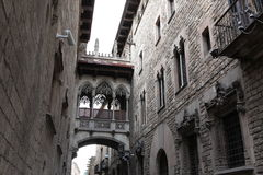 Bridge at Carrer del Bisbe in Barri Gotic Stock Images