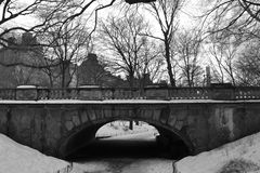 Bridge in Central Park under the Snow. Glade Arch in central Park Stock Photos