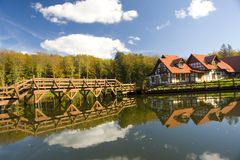 Bridge and chalet in woods Royalty Free Stock Images