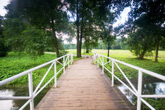 Bridge in charming park Royalty Free Stock Image
