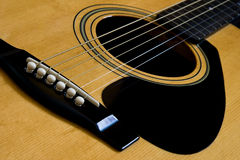 Bridge and chords. The bridge and strings of and acustic guitar Stock Image
