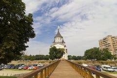The bridge and the church. ORADEA, ROMANIA, CIRCA JULY 2015 : The bridge and the Orthodox Episcopal Cathedral, Resurrection of Oradea, Romania Royalty Free Stock Photo