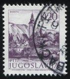 Bridge and church. RUSSIA KALININGRAD,12 NOVEMBER 2016: stamp printed by Yugoslavia, shows the bridge and church, circa 1971 royalty free stock photos