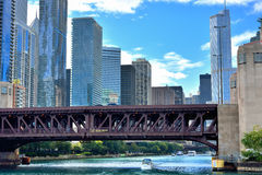 Bridge and city buildings, Chicago river. City buildings and bridge along the Chicago river, Chicago, Illinois, United States Stock Images