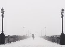 Bridge city landscape in foggy snowy winter day Royalty Free Stock Images
