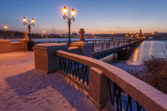 Bridge city landscape in snowy winter night Royalty Free Stock Photo