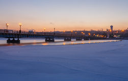 Bridge city landscape in snowy winter night Royalty Free Stock Photography