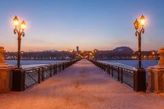 Bridge city landscape in snowy winter night Stock Photo