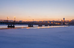 Bridge city landscape in snowy winter night Stock Photos