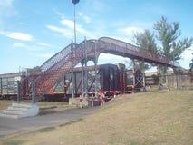 Bridge in the city next to the sky / Puente en la ciudad al lado del cielo. Un pequeño puente sobre las vías del tren, tocando el cielo / A small bridge stock images