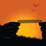 Bridge of the cliff with bats color vector illustration Royalty Free Stock Photography