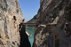 Bridge on a cliff. Dangerous path in the montains Stock Image