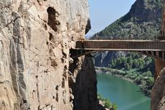 Bridge on a cliff. Dangerous path in the montains Royalty Free Stock Photo