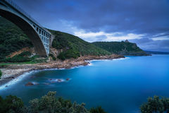 Bridge, cliff and sea. Leghorn coast, Tuscany riviera, Italy. Bridge, cliff and sea. Leghorn coast, Tuscany riviera Italy, Europe. Long Exposure stock photo