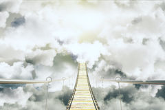 Bridge among the clouds concept Stock Images
