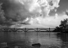 Bridge in clouds. Monochrome. The bridge of Preobrazhenskiy. Dnepr river. Zaporozhye. Ukraine. Monochrome Royalty Free Stock Image