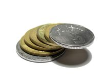 Bridge of coins. Closeup of a stack of coins forming a bridge royalty free stock photography