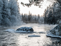 Bridge at cold winter day. Bridge over river at cold winter day in Finland Royalty Free Stock Photo