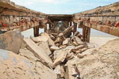 Bridge collapse. On the beach Royalty Free Stock Photography
