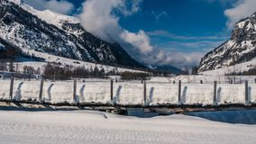 Bridge is completely snowed under. Clear sky`s above wild enormous mountains on a winters day stock photos