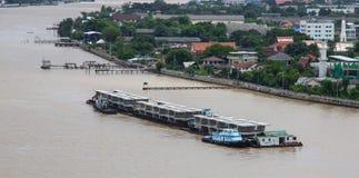 Bridge component loading. Bangkok, Thailand - July 29, 2017: Barge loading bridge components on Chaopraya river Stock Photos