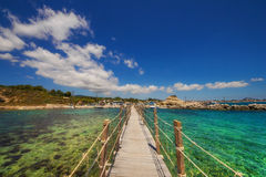 The bridge connecting the islet of Agios Sostis (Cameo Island) with Laganas town, Zakynthos. Greece royalty free stock image