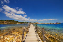 The bridge connecting the islet of Agios Sostis (Cameo Island) with Laganas town, Zakynthos. Greece stock images