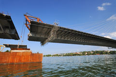 Bridge construction. Lifting last segment to the position Royalty Free Stock Image