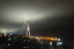 Bridge. Construction bridge in the city of Vladivostok in Russia at night, shrouded in clouds Royalty Free Stock Photo