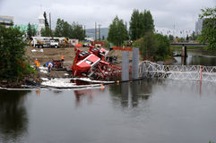 Bridge Construction Crane Topples over into River Stock Image