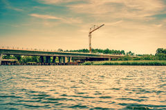 Bridge construction by the lake Stock Images