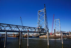 Bridge Construction. A new bridge under construction in the harbor stock image
