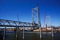 Bridge Construction. A new bridge under construction in the harbor Stock Image