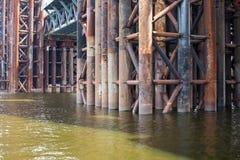 Bridge construction. Rusty metal piers. Stock Image