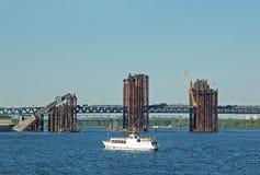 Bridge construction site and boat. Bridge construction site across Dnieper river, Kiev, Ukraine Stock Images