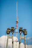 Bridge construction site with tower cranes Stock Images