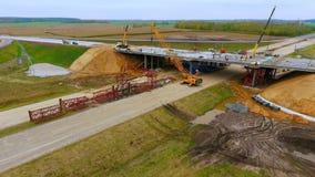 Bridge construction. Sky view of crawler crane repair bridge over highway road