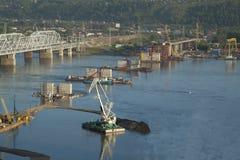 Bridge construction through Yenisei. For cars Stock Photos