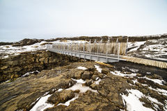 Bridge between Continents. The Bridge between two continents at Sandvík, on the Reykjanes peninsula of south west Iceland, is a small footbridge over a major stock photos