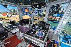 The bridge and controls of a modern tugboat royalty free stock images