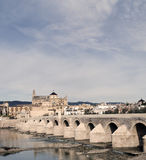 Bridge of Cordoba. Cathedral next to the mosque of Cordoba, image taken from the base of the bridge, the river is Giuadalquivir passage through the city Royalty Free Stock Image