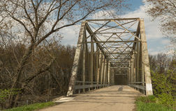 Bridge in the country. Old metal bridge in rural Peru, Illinois on a Spring afternoon Royalty Free Stock Images
