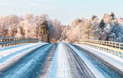 Bridge on country road on a sunny winter day royalty free stock photo