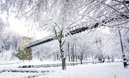 Bridge covered in snow. A beautiful bridge covered in snow Stock Photos