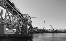 The bridge and the crane on the river. Black and white version Stock Photos