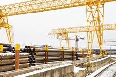 Bridge cranes over railroad in outdoor warehouse Stock Photos