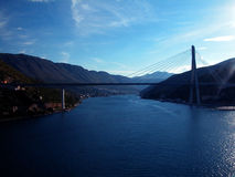 Bridge in Croatia. A view of a suspended bridge spanning across a waterway in Croatia Stock Photography